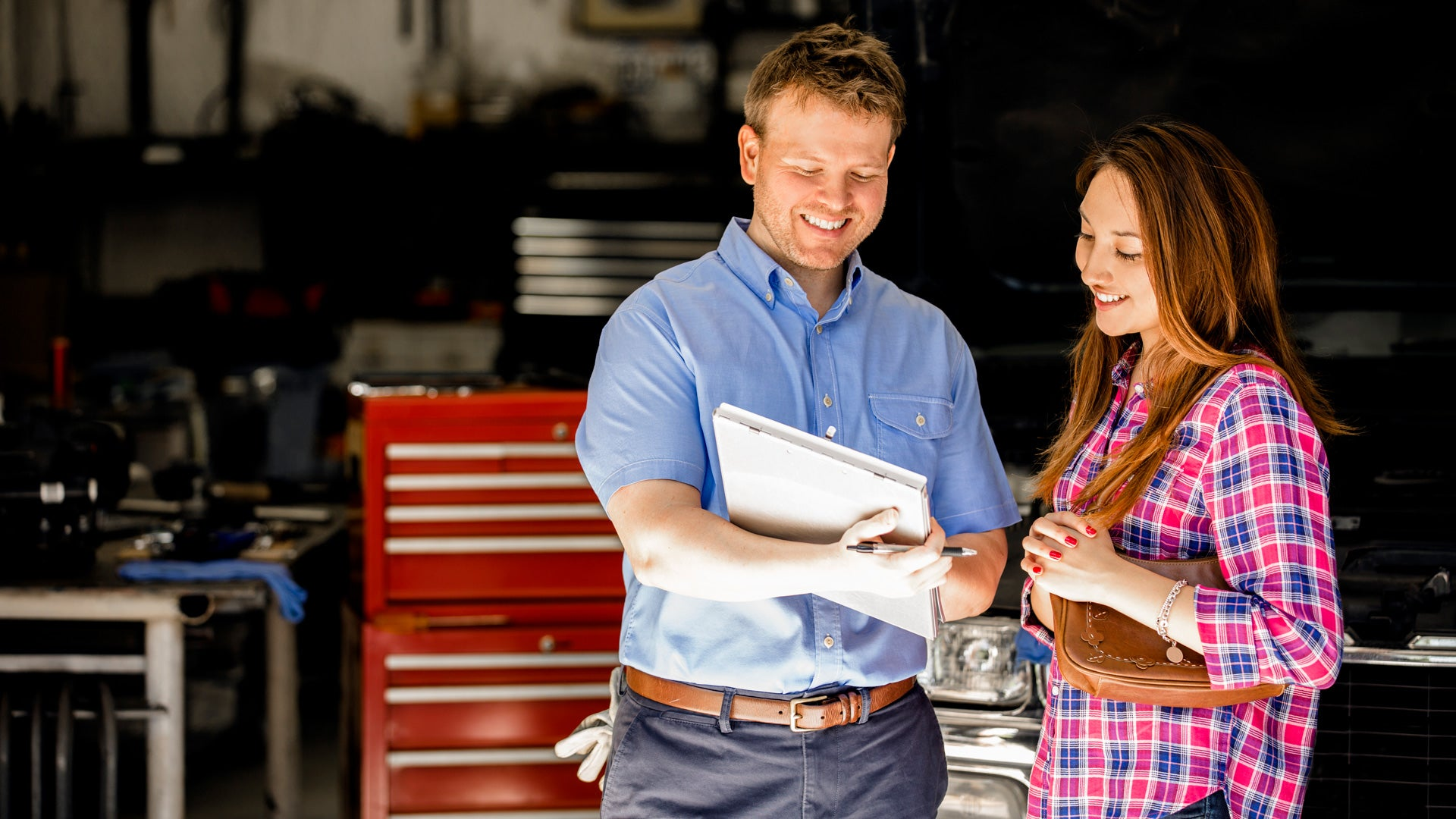 woman-in-car-garage-with-mechanic-insights.jpg
